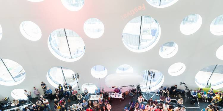 Image taken from level 4 inside Ravensbourne building looking down on an event